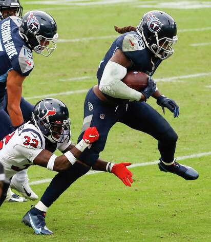 Tennessee Titans running back Derrick Henry (22) breaks away from Houston Texans cornerback Lonnie Johnson (32) for a first down run during overtime of an NFL football game at Nissan Stadium on Sunday, Oct. 18, 2020, in Nashville. Photo: Brett Coomer, Staff Photographer / © 2020 Houston Chronicle