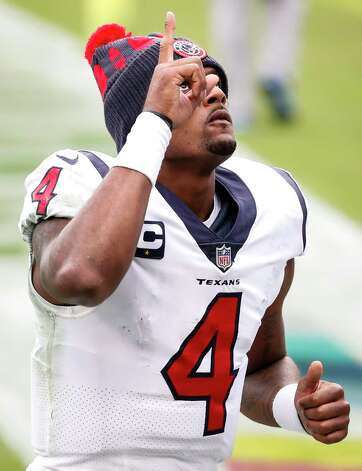 Houston Texans quarterback Deshaun Watson (4) points to the sky as he leaves the field following an overtime loss to the Tennessee Titans in an NFL football game at Nissan Stadium on Sunday, Oct. 18, 2020, in Nashville. Photo: Brett Coomer, Staff Photographer / © 2020 Houston Chronicle