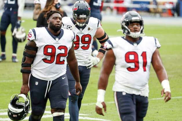 Houston Texans defensive end J.J. Watt (99), nose tackle Brandon Dunn (92) and defensive end Carlos Watkins (91) walk off the field after the Texans lost to the Tennessee Titans in overtime of an NFL football game at Nissan Stadium on Sunday, Oct. 18, 2020, in Nashville. Photo: Brett Coomer, Staff Photographer / © 2020 Houston Chronicle