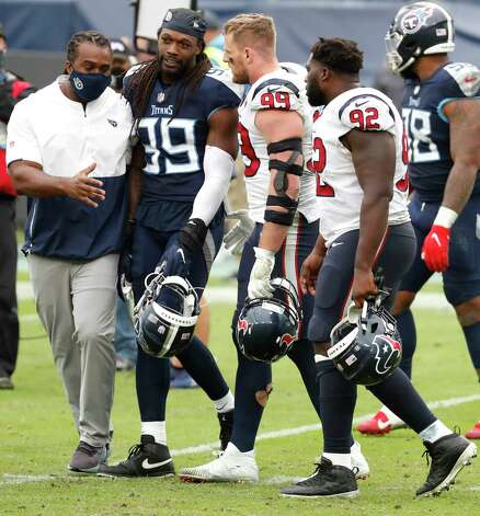 Houston Texans defensive end J.J. Watt (99) and Tennessee Titans outside linebacker Jadeveon Clowney embrace after the Titans beat the Texans in overtime of an NFL football game at Nissan Stadium on Sunday, Oct. 18, 2020, in Nashville. Photo: Brett Coomer, Staff Photographer / © 2020 Houston Chronicle