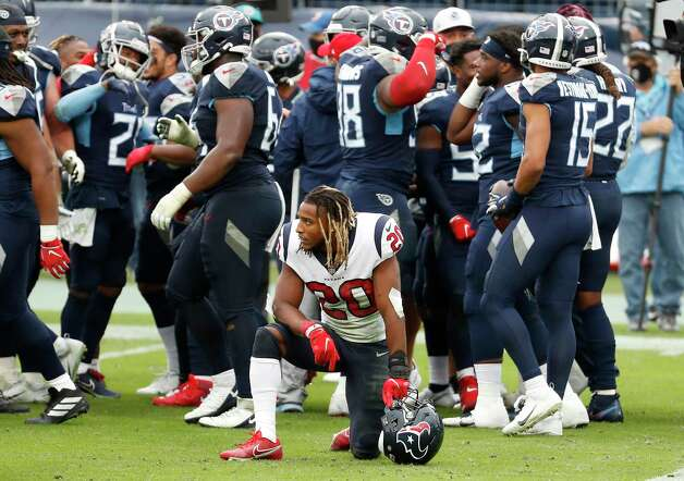 Houston Texans strong safety Justin Reid (20) kneels on the field as the Tennessee Titans celebrate running back Derrick Henry's game-winning 45-yard touchdown run during overtime of an NFL football game at Nissan Stadium on Sunday, Oct. 18, 2020, in Nashville. Photo: Brett Coomer, Staff Photographer / © 2020 Houston Chronicle