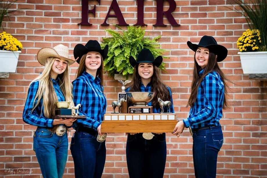 From left, Lola Smith, Morgan Glann, Jenna Holzinger, and Cammy Ankoviak make up the Meridian Early College High School equestrian team that won the Division C state championship on Sunday at the Michigan Interscholastic Horsemanship Association State Championship at the Midland County Fairgrounds. Photo: Photo Provided/Sarah Glann