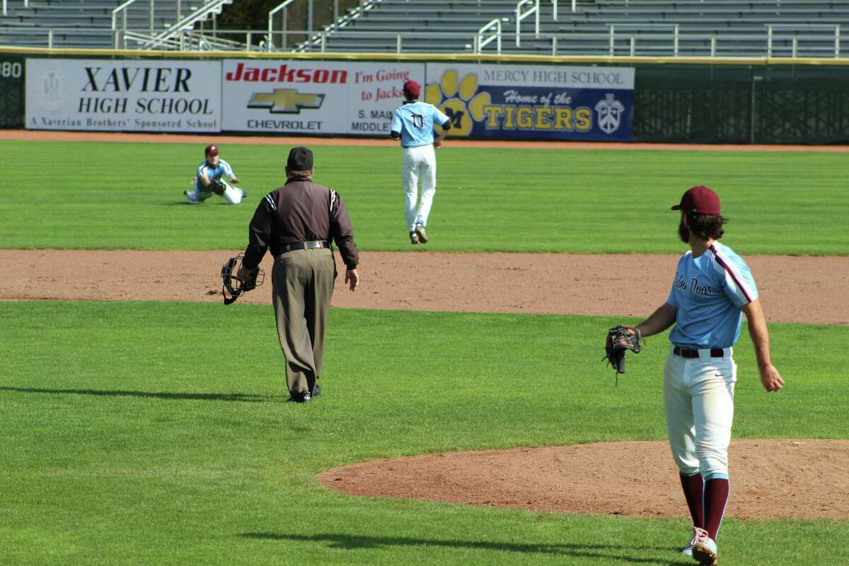 Palmer Dogs center fielder Owen Clancy goes to his knees to make an inning-ending catch in the second inning Sunday.