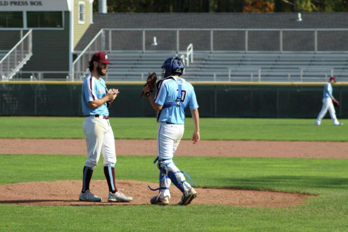 Middletown Palmer Dogs pitcher Logan Wenzel, left, with catcher Mike Garofalo.