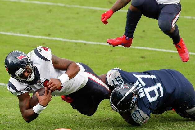 Houston Texans quarterback Deshaun Watson (4) is stopped short of the goal line by Tennessee Titans defensive tackle Isaiah Mack (97) during the fourth quarter of an NFL football game at Nissan Stadium on Sunday, Oct. 18, 2020, in Nashville. Photo: Brett Coomer, Staff Photographer / © 2020 Houston Chronicle