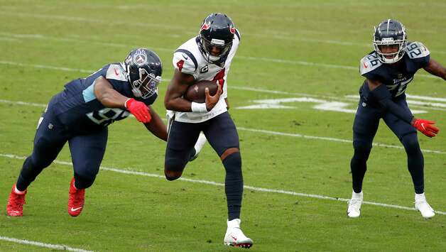 Houston Texans quarterback Deshaun Watson (4) runs the ball past Tennessee Titans defensive tackle Isaiah Mack (97) during the fourth quarter of an NFL football game at Nissan Stadium on Sunday, Oct. 18, 2020, in Nashville. Photo: Brett Coomer, Staff Photographer / © 2020 Houston Chronicle