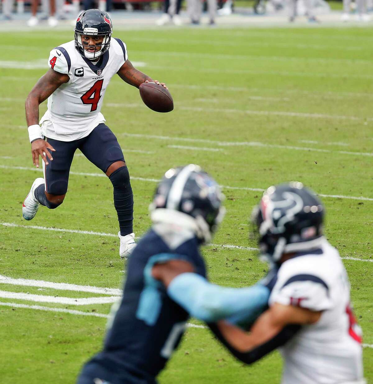 Houston Texans quarterback Deshaun Watson (4) rolls out to pass against the Tennessee Titans during the fourth quarter of an NFL football game at Nissan Stadium on Sunday, Oct. 18, 2020, in Nashville.