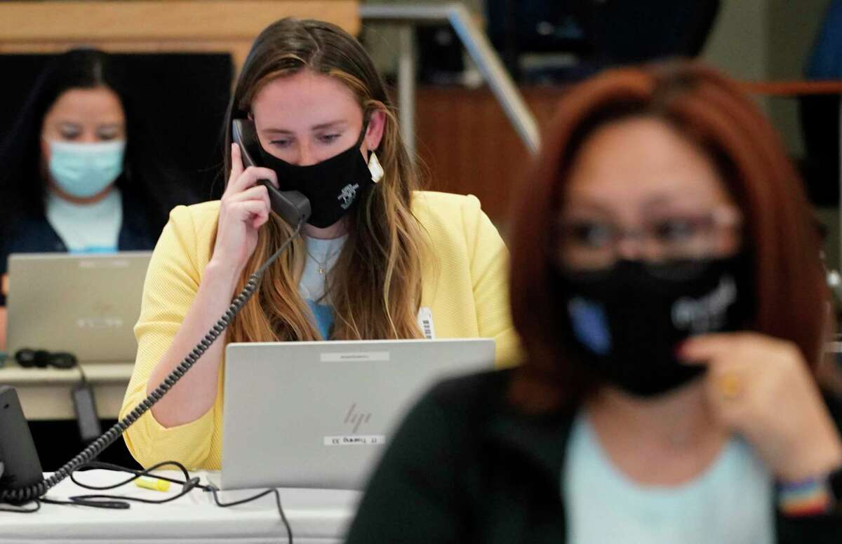 Amy Poerschke, a Houston ISD school support officer, center, works during a district-hosted phone bank held at the Hattie Mae White Educational Support Building 4400 W. 18th St., on Friday, Oct. 16, 2020 in Houston. HISD plans on returning to in-person classes on Monday. HISD staff members took calls on a variety of topics such as virtual and in-person instruction options, testing and attendance, meals, and COVID-19.