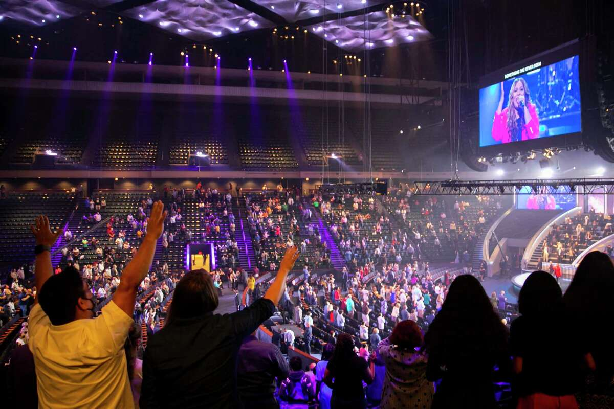 People worship during the 8:30 a.m. service at Lakewood Church during the first day of reopening for in-person services on Sunday after being closed since March on Sunday, Oct. 18, 2020.