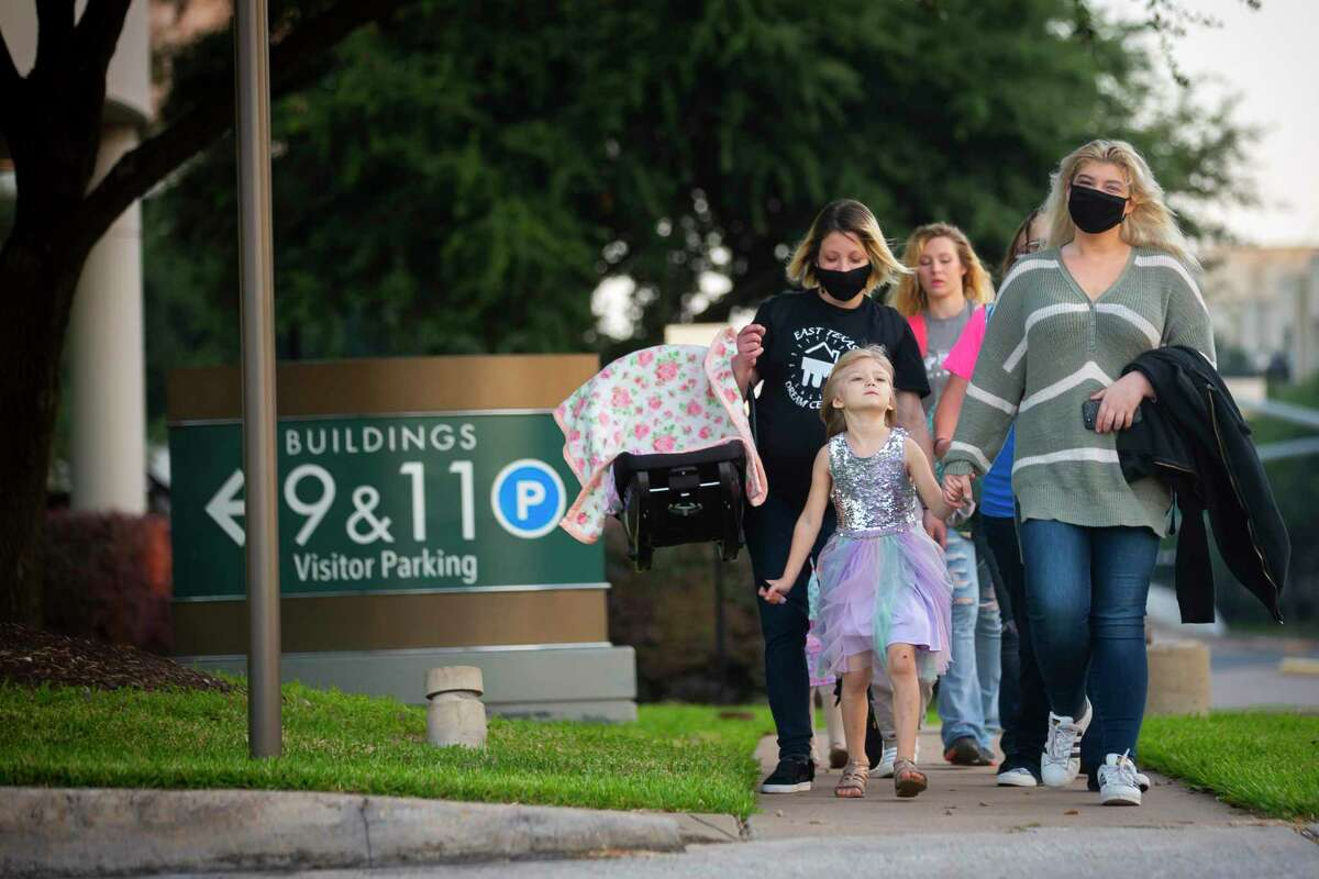 People walk towards Lakewood Church after parking for the 8:30 a.m. service at Lakewood Church during the first day of reopening for in-person services on Sunday after being closed since March on Sunday, Oct. 18, 2020.