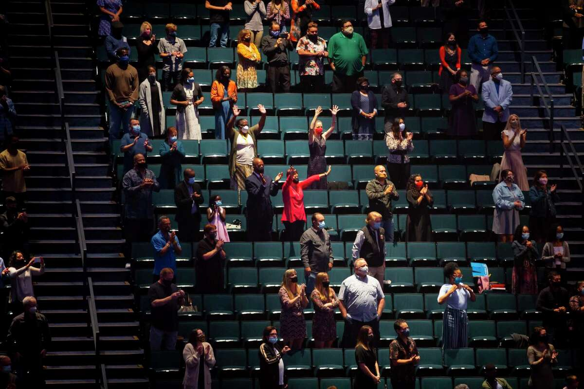 Attendees worship during Lakewood Church's first day of reopening for in-person services on Sunday after being closed since March on Sunday, Oct. 18, 2020.