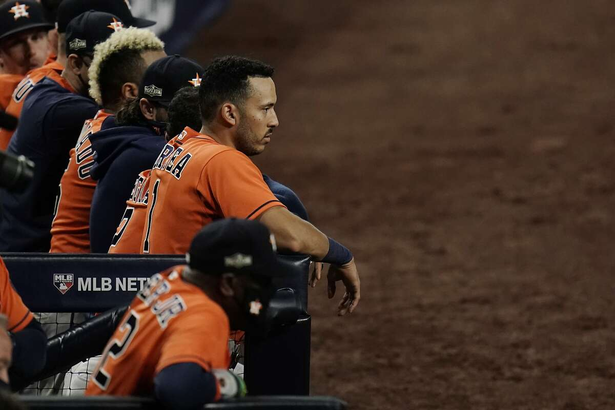 Shortstop Carlos Correa, manager Dusty Baker (foreground) and the rest of the Houston Astros watch the eighth inning of Game 7 of the ALCS from the dugout in San Diego.