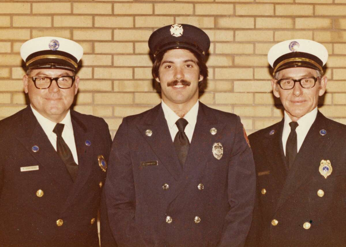 """Ron """"Pee Wee"""" Campbell, Brad Campbell and Byron """"Sonny"""" Campbell pose for a photo in December 1978, Brad's rookie year with the Jacksonville Fire Department."""