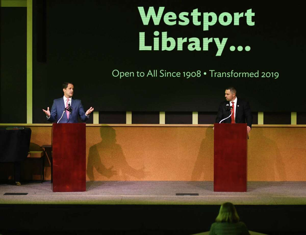 U.S. Rep. Jim Himes, D-Conn., left, and Republican challenger Jonathan Riddle speak during the 4th District debate at the Westport Library's Trefz Forum on Sunday.