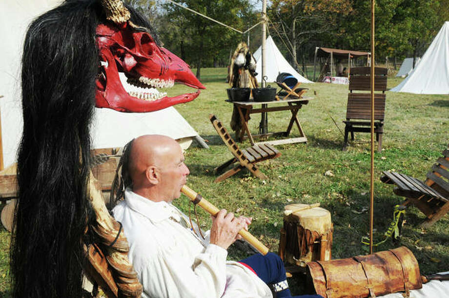 Scott Harris, of West Frankfort, demonstrates a Native American musical instrument during the Grafton Rendezvous Sunday.