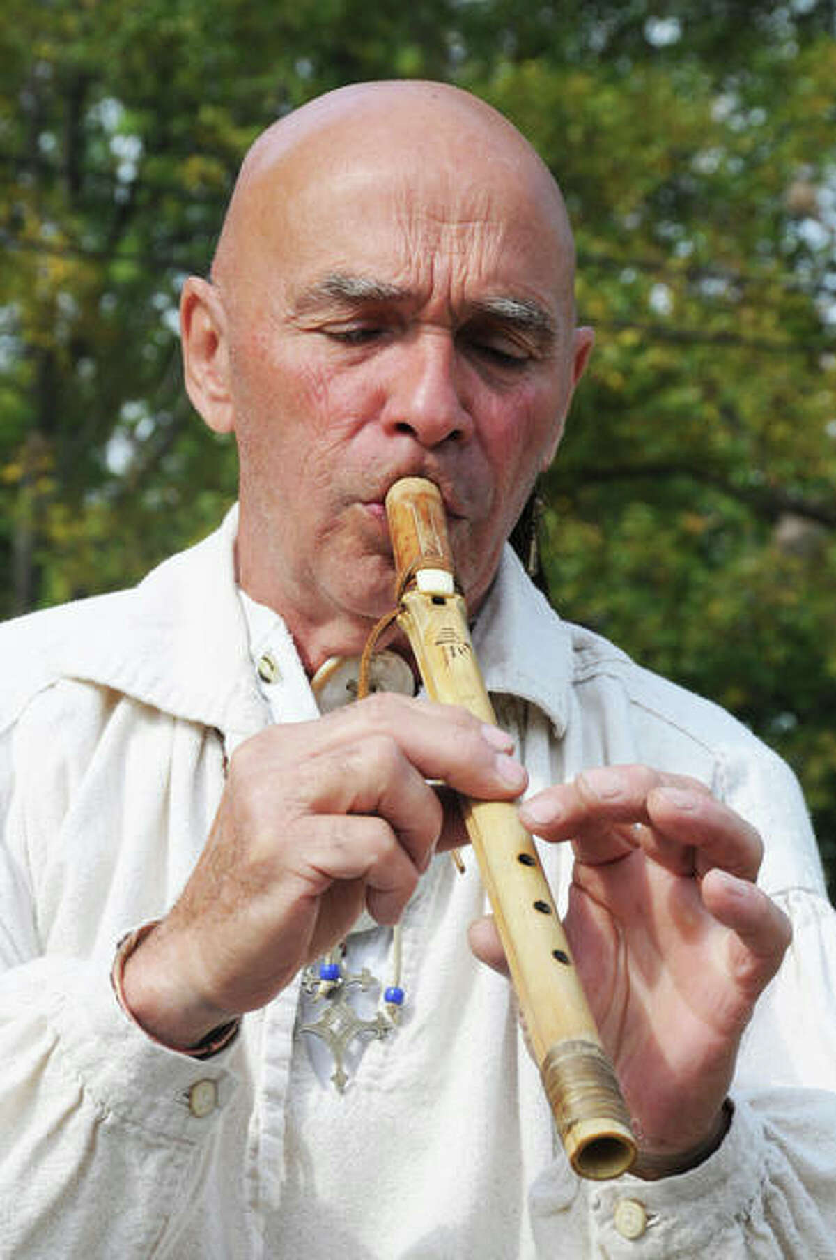 Harris plays a Native American musical instrument during the Grafton Rendezvous Sunday.