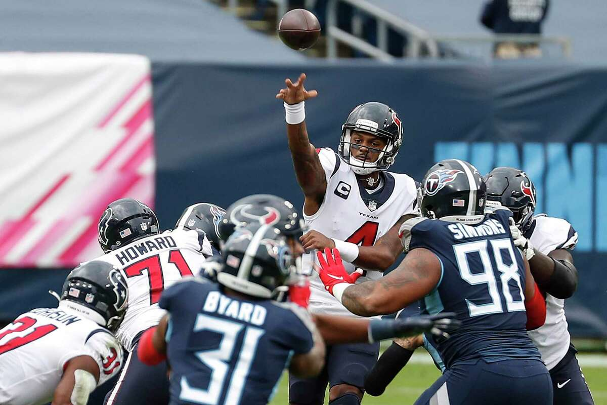 Houston Texans quarterback Deshaun Watson (4) throws to running back David Johnson (31) against the Tennessee Titans during the first half of an NFL football game at Nissan Stadium on Sunday, Oct. 18, 2020, in Nashville.