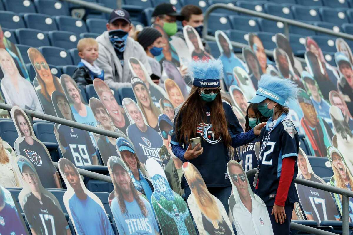 Tennessee Titans fans make their way to their seats before an NFL football game against the Houston Texans at Nissan Stadium on Sunday, Oct. 18, 2020, in Nashville.