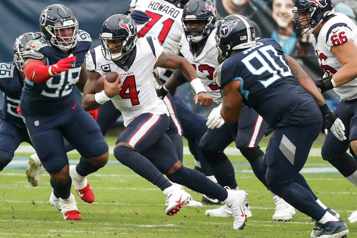 Houston Texans quarterback Deshaun Watson (4) scrambles out of the pocket past Tennessee Titans defensive tackle Jeffery Simmons (98) and defensive tackle DaQuan Jones (90) during the first half of an NFL football game at Nissan Stadium on Sunday, Oct. 18, 2020, in Nashville.