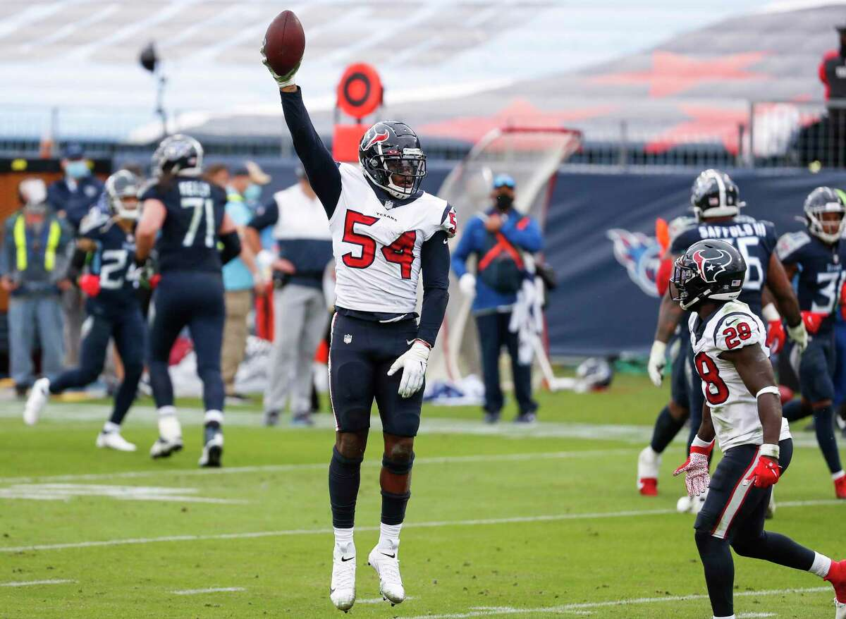 Houston Texans linebacker Jake Martin (54) celebrates after recovering a fumble by Tennessee Titans quarterback Ryan Tannehill during the third quarter of an NFL football game at Nissan Stadium on Sunday, Oct. 18, 2020, in Nashville.