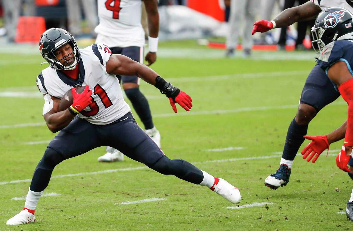 Houston Texans running back David Johnson (31) runs the ball against the Tennessee Titans during the third quarter of an NFL football game at Nissan Stadium on Sunday, Oct. 18, 2020, in Nashville.