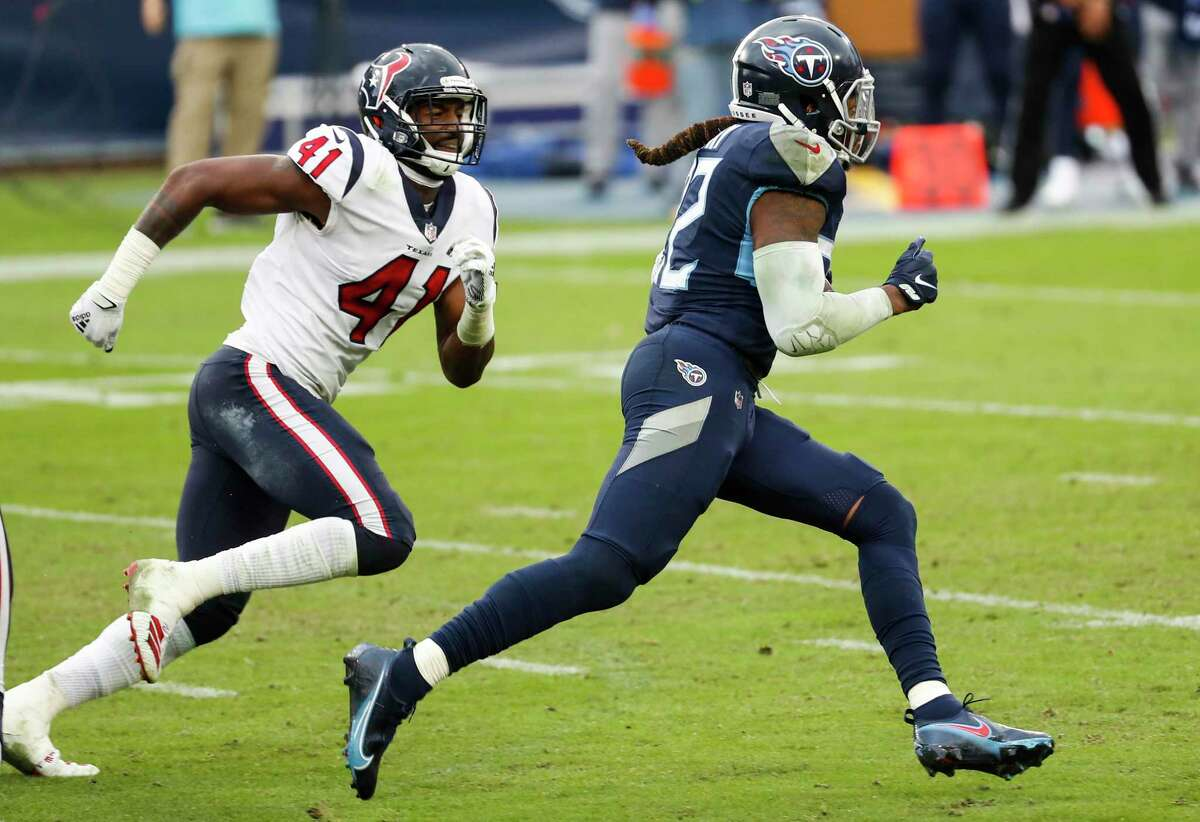 Tennessee Titans running back Derrick Henry (22) breaks past Houston Texans inside linebacker Zach Cunningham (41) for a 94-yard touchdown run during the fourth quarter of an NFL football game at Nissan Stadium on Sunday, Oct. 18, 2020, in Nashville.
