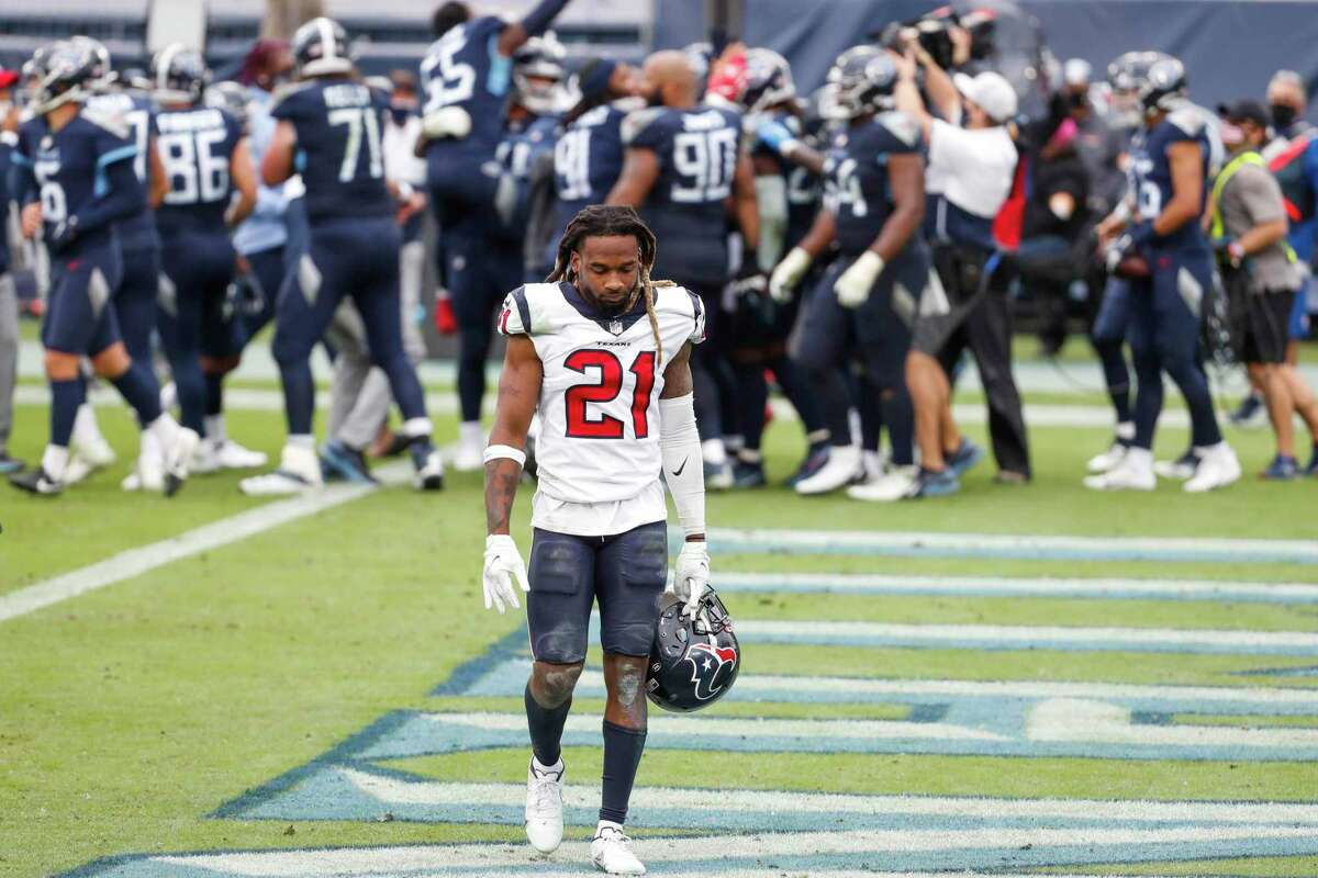 Houston Texans cornerback Bradley Roby (21) walks off the field as the Tennessee Titans celebrates running back Derrick Henry's game winning 5-yard touchdown run during overtime of an NFL football game at Nissan Stadium on Sunday, Oct. 18, 2020, in Nashville.