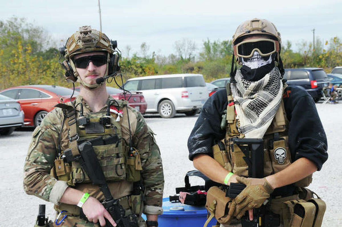 Conor Villhard and Jacob Wickline, of O'Fallon, Illinois, prepare to do battle Sunday during Operation Dark Harvest X - Airsoft Big Game.