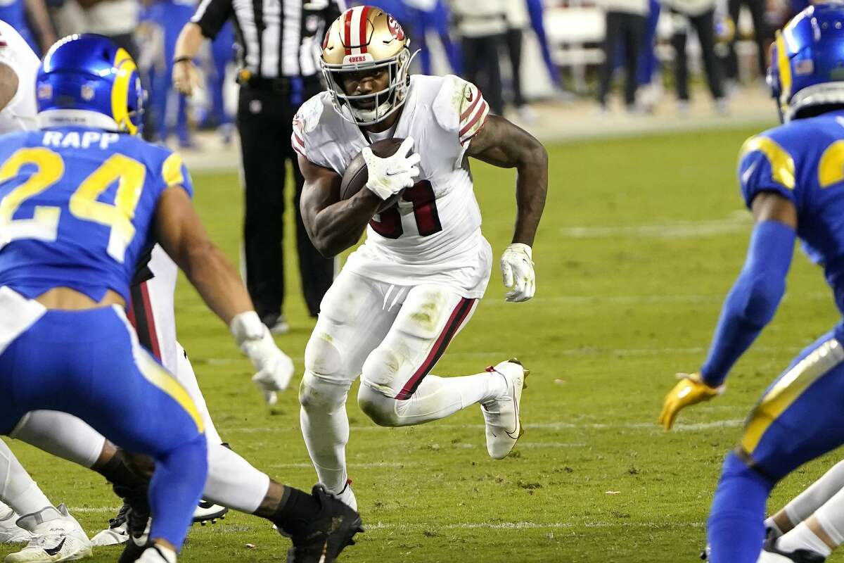 Raheem Mostert #31 of the San Francisco 49ers carries the ball against the Los Angeles Rams during the second quarter at Levi's Stadium on October 18, 2020 in Santa Clara, California. (Photo by Thearon W. Henderson/Getty Images)