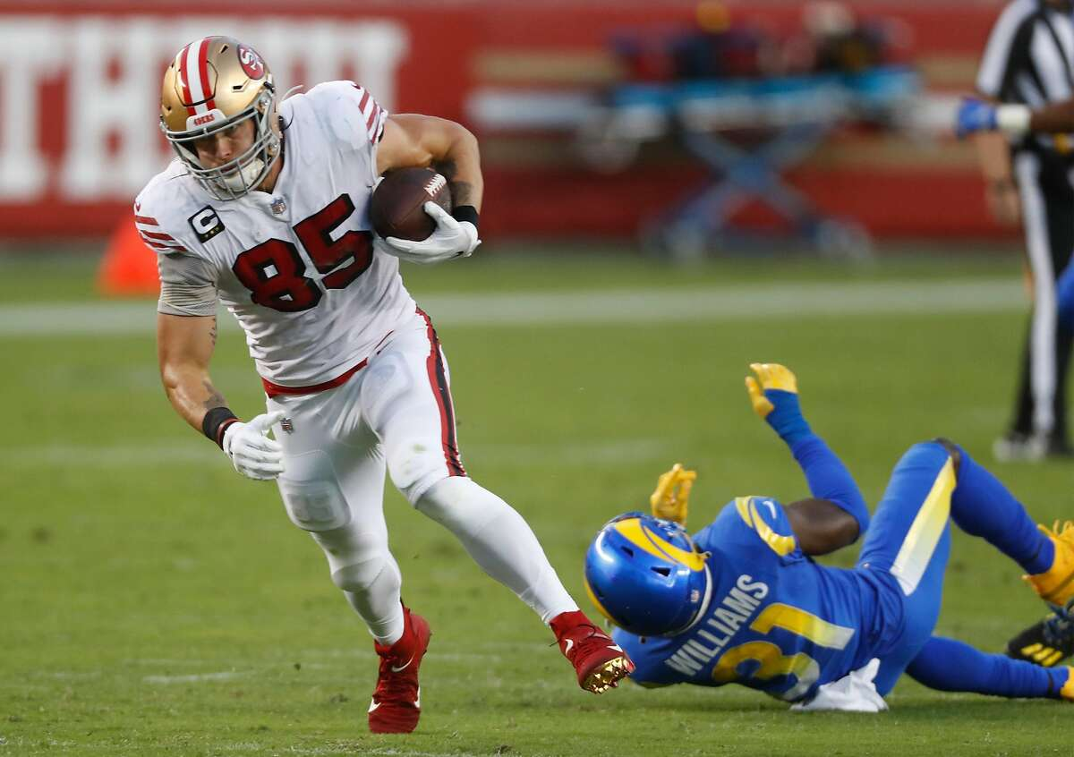 49ers tight end George Kittle leaves the Rams' Darious Williams behind on his 44-yard touchdown catch in the second quarter.