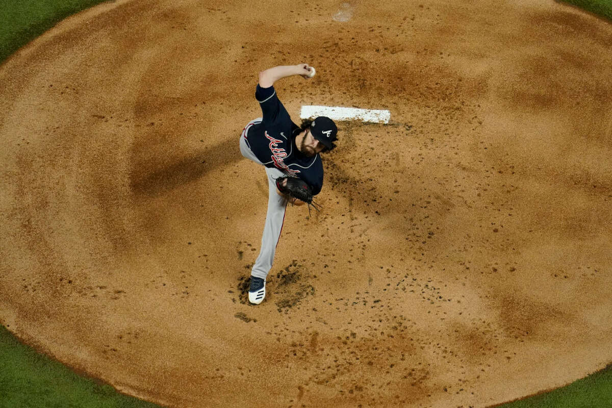 Atlanta Braves starting pitcher Ian Anderson throws against the Los Angeles Dodgers during the first inning in Game 7 of a baseball National League Championship Series Sunday, Oct. 18, 2020, in Arlington, Texas. (AP Photo/David J. Phillip)