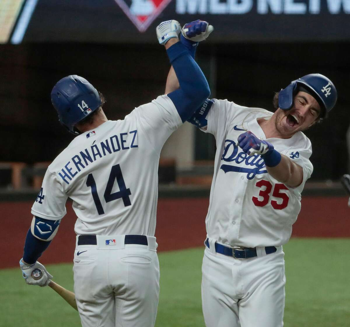 Dodgers center fielder Cody Bellinger celebrates with Kiké Hernandez after hitting the go-ahead homer in the seventh.