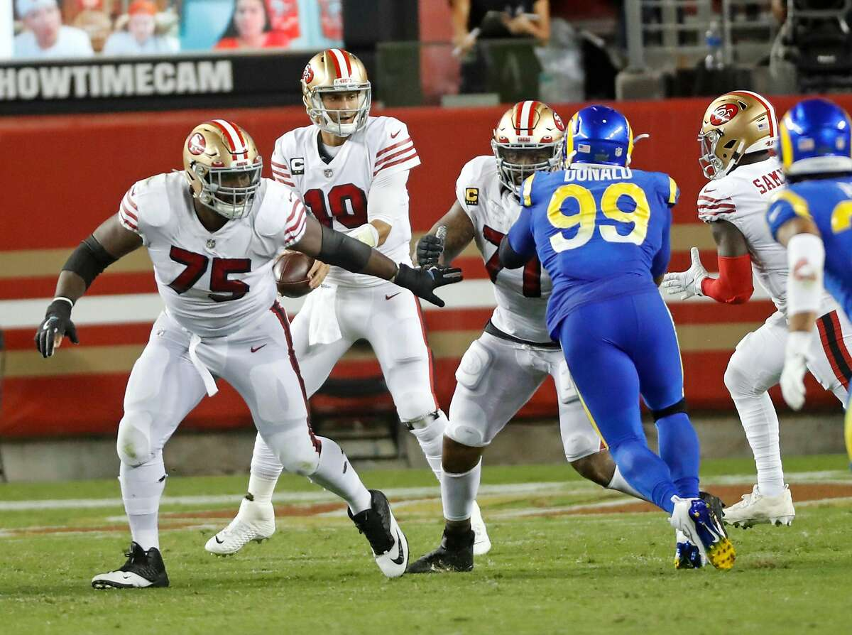 San Francisco 49ers' Laken Tomlinson and Trent Williams block Los Angeles Rams' Aaron Donald in 2nd quarter of Non era' 24-16 win during NFL game at Levi's Stadium in Santa Clara, Calif., on Sunday, October 18, 2020.