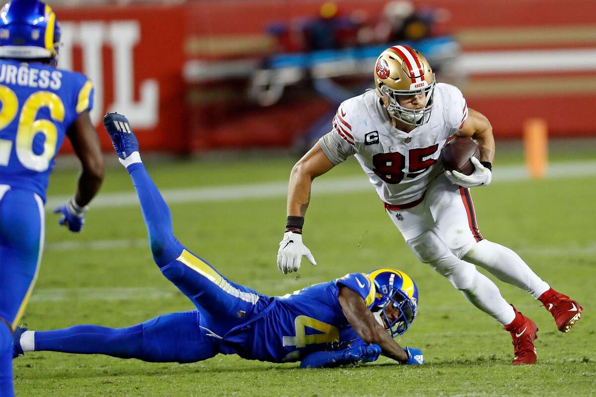 Tight end George Kittle runs for a first down in front of the Rams' John Johnson III in last Sunday's win.