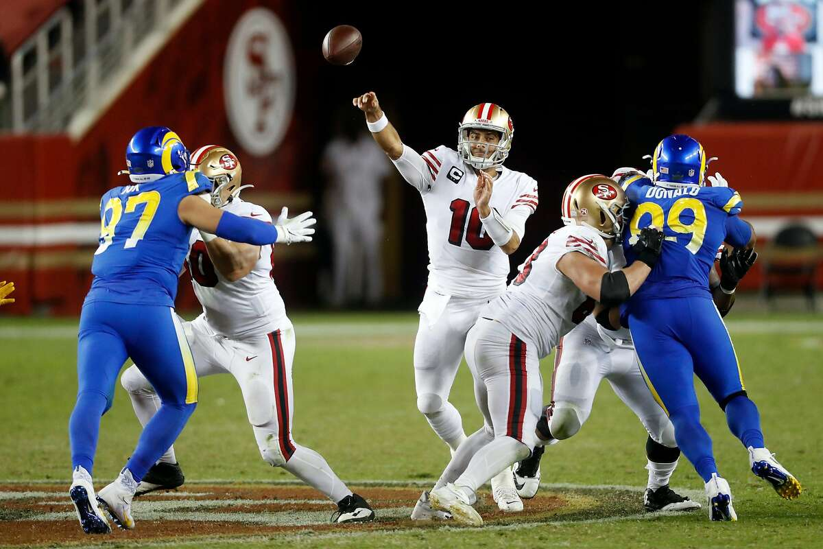 San Francisco 49ers' Jimmy Garoppolo passes in 4th quarter of 24-16 win over Los Angeles Rams during NFL game at Levi's Stadium in Santa Clara, Calif., on Sunday, October 18, 2020.