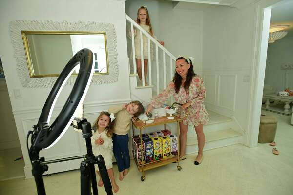 Darien resident Shannon Doherty with her children, Leontine, 7, Colton, 5, and Fallon, 3, at their home Friday, October 16, 2020,in Darien, Conn. Doherty has become popular on TikTok with the sanitizing station she created for her children. She was recently featured on Good Morning America.