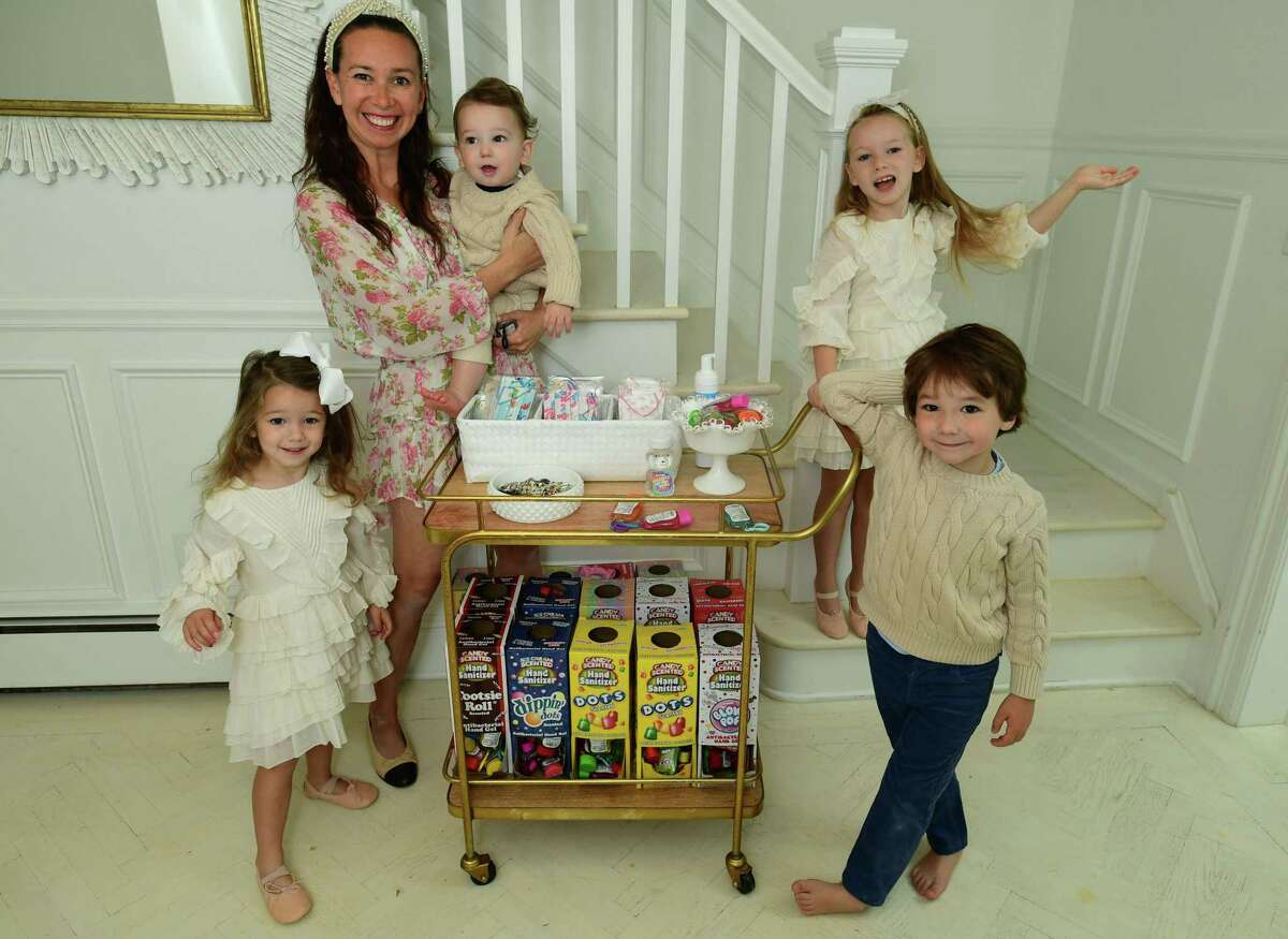 Darien resident Shannon Doherty with her children, Leontine, 7, Colton, 5, Fallon, 3, and Hunter, 1, at their home Friday, October 16, 2020,in Darien, Conn. Doherty has become popular on TikTok with the sanitizing station she created for her children. She was recently featured on Good Morning America.