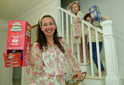 Darien resident Shannon Doherty with her children, Leontine, 7, and Colton, 5, at their home Friday, October 16, 2020,in Darien, Conn. Doherty has become popular on TikTok with the sanitizing station she created for her children. She was recently featured on Good Morning America.