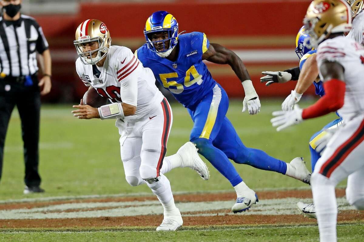 San Francisco 49ers' Jimmy Garoppolo scrambles in front of Los Angeles Rams' Leonard Floyd during 4th quarter of Niners' 24-16 win in NFL game at Levi's Stadium in Santa Clara, Calif., on Sunday, October 18, 2020.