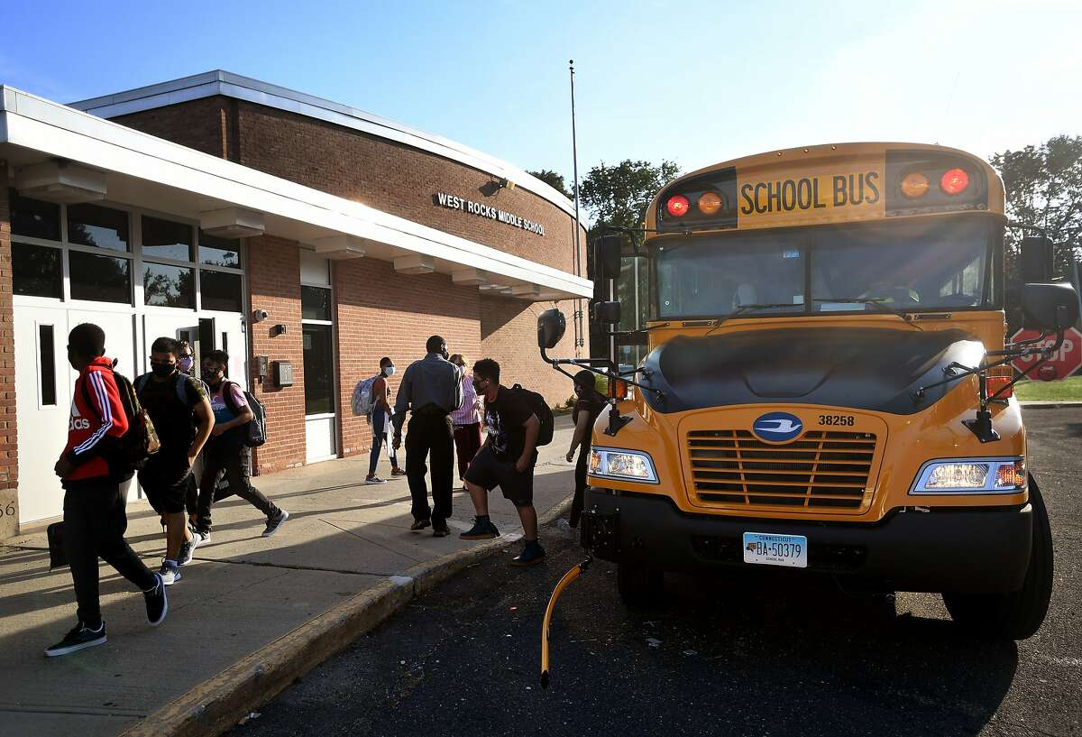 Students arrive for the first day of classes at West Rocks Middle School in Norwalk, Conn. on Tuesday, September 8, 2020.