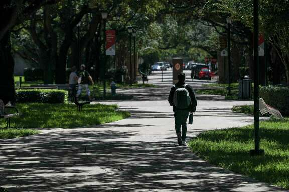 A student walks through campus Tuesday, Sept. 29 2020, at the University of St. Thomas in Houston.