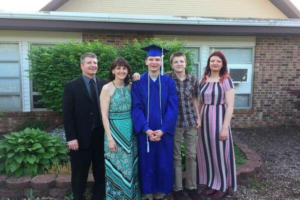 Pictured, from left, are David, Christa, Joshua, Caleb and Rebecca Krohn at Joshua's graduation from Midland Christian School in 2019. (Photo provided/David Krohn)