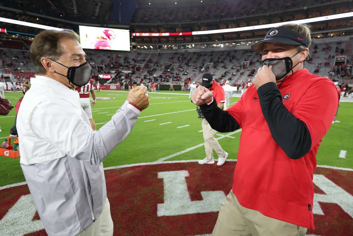 Head Coach Nick Saban of the Alabama Crimson Tide meets Head Coach Kirby Smart of the Georgia Bulldogs on the field at Bryant-Denny Stadium on Oct. 17, 2020, in Tuscaloosa, Ala.