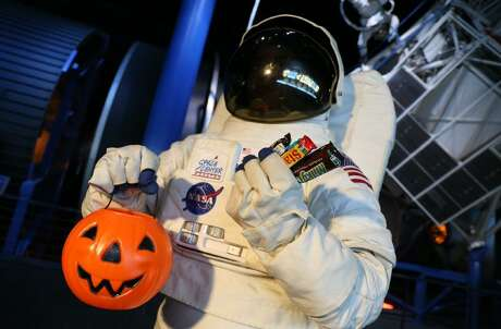 Candy grab bags and costumes on parade are part of the fun at Space Center Houston's Galaxy Frights.