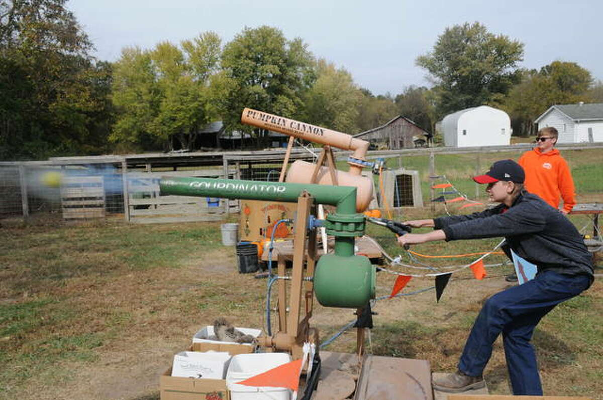 Vincent Smith, 13, of Staunton fires the gourd shooter on Sunday during Boonies Farm Fall Days outside of Worden.