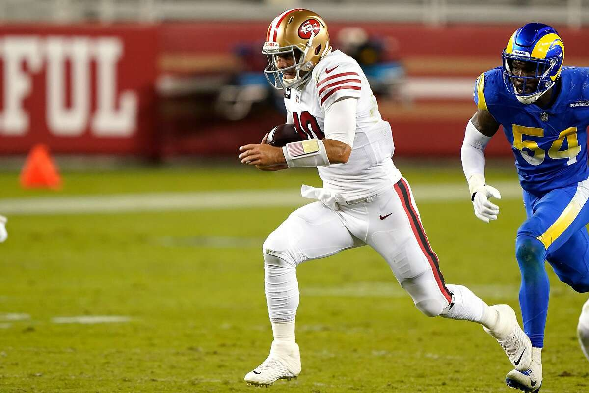 SANTA CLARA, CALIFORNIA - OCTOBER 18: Jimmy Garoppolo #10 of the San Francisco 49ers runs against Leonard Floyd #54 of the Los Angeles Rams during the fourth quarter at Levi's Stadium on October 18, 2020 in Santa Clara, California. (Photo by Thearon W. Henderson/Getty Images)