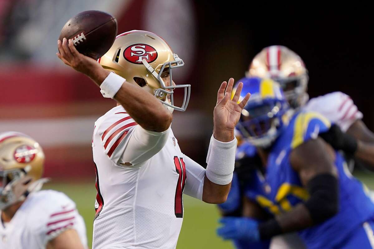 SANTA CLARA, CALIFORNIA - OCTOBER 18: Jimmy Garoppolo #10 of the San Francisco 49ers passes against the Los Angeles Rams during the first quarter at Levi's Stadium on October 18, 2020 in Santa Clara, California. (Photo by Thearon W. Henderson/Getty Images)