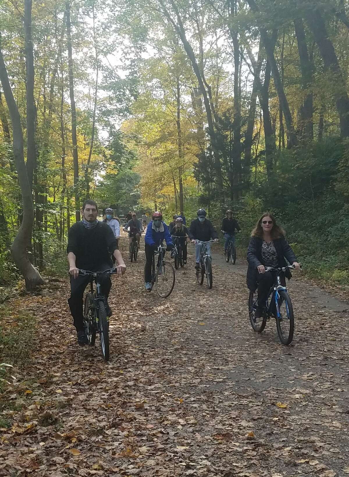 Local rail-trail historian/author, Sue A. DelBianco, pictured right/front in the bottom photo, brings a group of cyclists on a journey back in time to when train was king. She stopped off at many historical sites along the rail-trail in the Trumbull Valley on Sunday, Oct. 18. The site included a cow tunnel, site of a train wreck from 1901, remains of an ice house, a knit mill, an amusement park called Parlor Rock, two train stations and more. DelBianco tells the story of why the railroad vanished, and how it was turned into one of Connecticut's best recreational trails. Another historical bike tour is planned for May, 2021, which will be announced in The Trumbull Times.