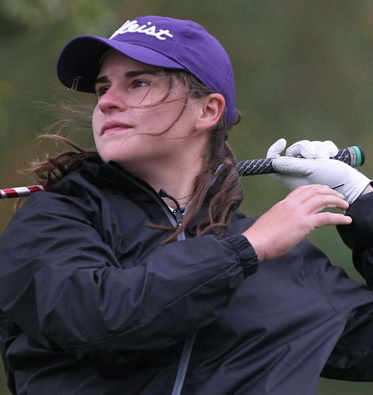 Routt's Addie Dobson follows through on a swing during the Rochester Sectional at The Rail Golf Course in Springfield Thursday. Dobson finished in fifth place.
