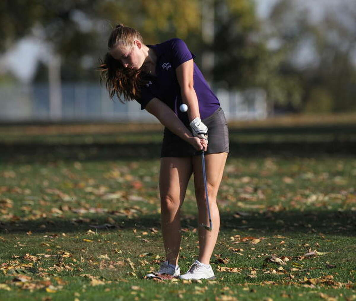 Routt's Makenna Baptist pops the ball up during practice Wednesday.